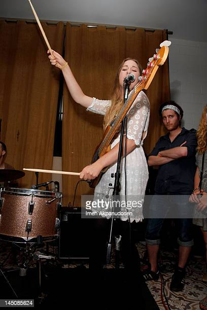 Bassist Este Haim of HAIM performs at the Nudie Jeans event at the Palihouse on May 22 2012 in West Hollywood California