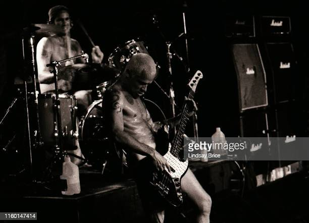 Bassist Flea and drummer Chad Smith perform in Red Hot Chili Peppers for Rock for Choice at the Hollywood Palladium on September 27 1992 in Los...