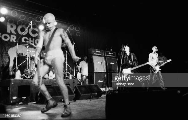Bassist Flea dances to the beat as he performs with drummer Chad Smith vocalist Anthony Kiedis and guitarist Arik Marshall in Red Hot Chili Peppers...