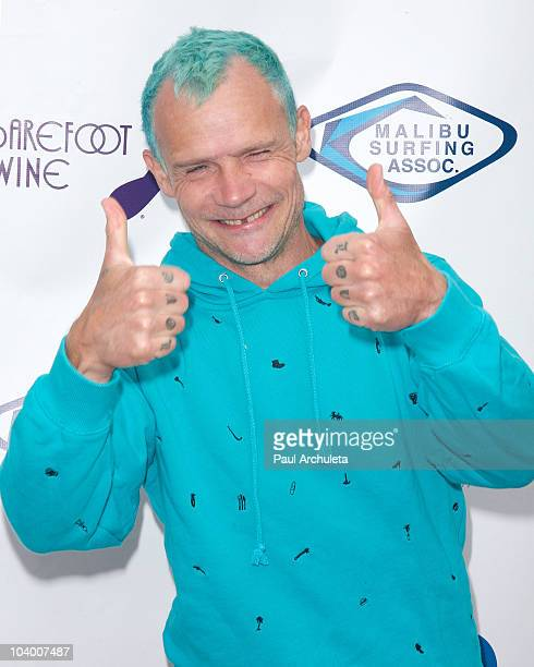 Bassist Flea of The Red Hot Chili Peppers attends the Surfrider Foundation's 5th annual celebrity expression session at First Point Surfrider Beach...