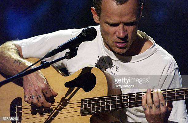 Bassist Flea of The Red Hot Chili Peppers performs at the 'ReAct Now Music Relief' benefit concert at Paramount Studios on September 9 2005 in...