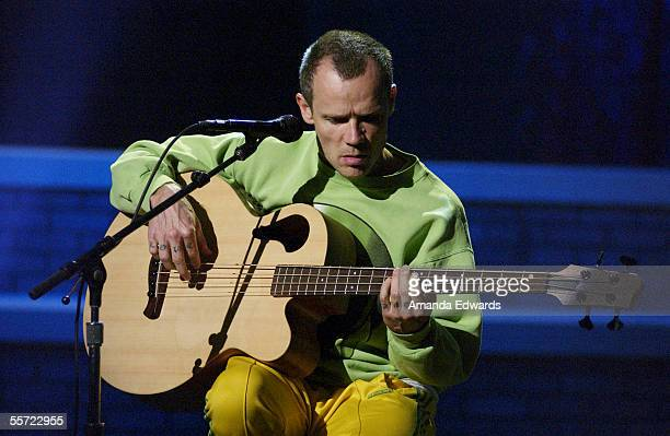 Bassist Flea of The Red Hot Chili Peppers rehearses at the ReAct Now Music Relief benefit concert at Paramount Studios on September 9 2005 in...