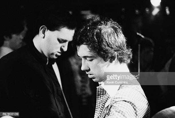 Bassist Garth Smith and singer Pete Shelley of English punk band Buzzcocks at Jenks club Blackpool Lancashire 3rd October 1977