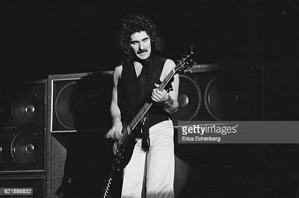Bassist Geezer Butler of Black Sabbath performs on stage at Hammersmith Odeon London January 1976