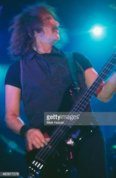 Bassist Geezer Butler performing with British heavy metal group Black Sabbath at the Hammersmith Apollo London 13th April 1994