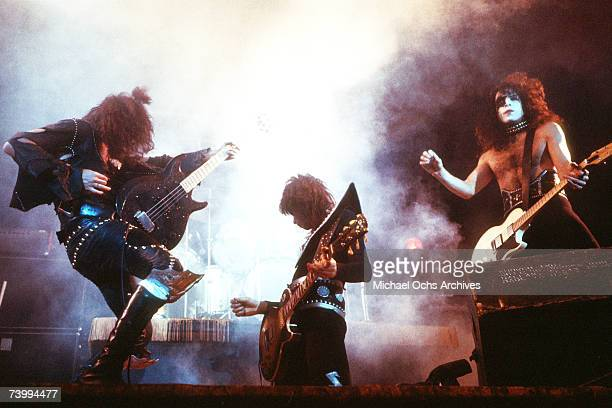 Bassist Gene Simmons guitarists Ace Frehley and Paul Stanley of the rock and roll band Kiss performs onstage at the Civic Auditorium on May 31 1974...