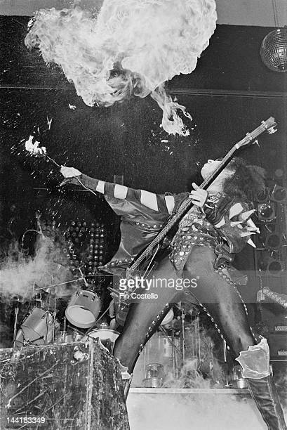 Bassist Gene Simmons of American heavy metal group Kiss adds fire-eating to the group's performance at the Calderone Theater, New York, 24th August...