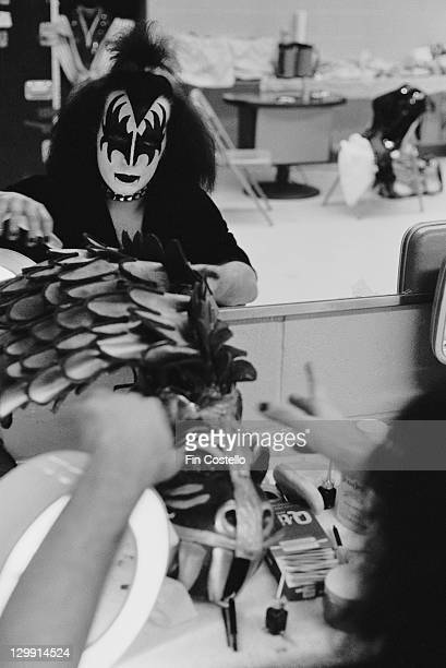 Bassist Gene Simmons of American heavy metal group Kiss in his dressing room circa 1975