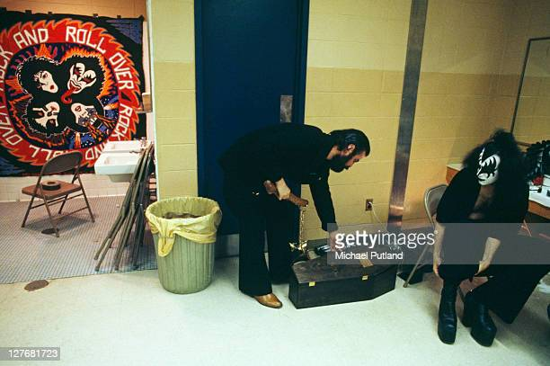 Bassist Gene Simmons of American rock group Kiss backstage during the band's Rock Roll Over Tour circa 1977