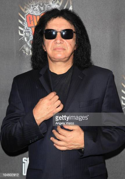 """Bassist Gene Simmons of the band """"Kiss"""" arrives at the launch of Activision's 'Guitar Hero: Warriors of Rock with Soundgarden' at Paramount Studios..."""