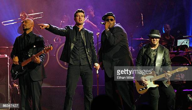 Bassist Greg Malone singer Robin Thicke musical director/keyboardist Larry Cox and guitarist Andrew McKay perform at The Pearl concert theater at the...