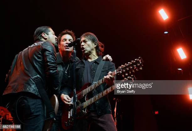 Bassist Hector Maldonado singer Pat Monahan and guitarist Luis Maldonado of Train perform during SiriusXMs Final Dress Rehearsal special exclusively...