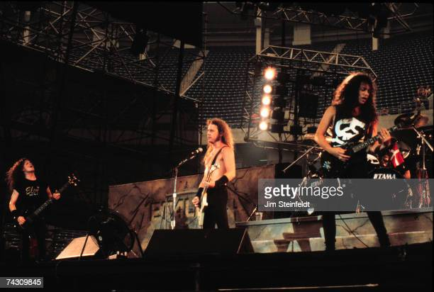 Bassist Jason Nestwed singer and guitarist James Hetfield and guitarist Kirk Hammett of the heavy metal quartet Metallica performs onstage in 1988 in...