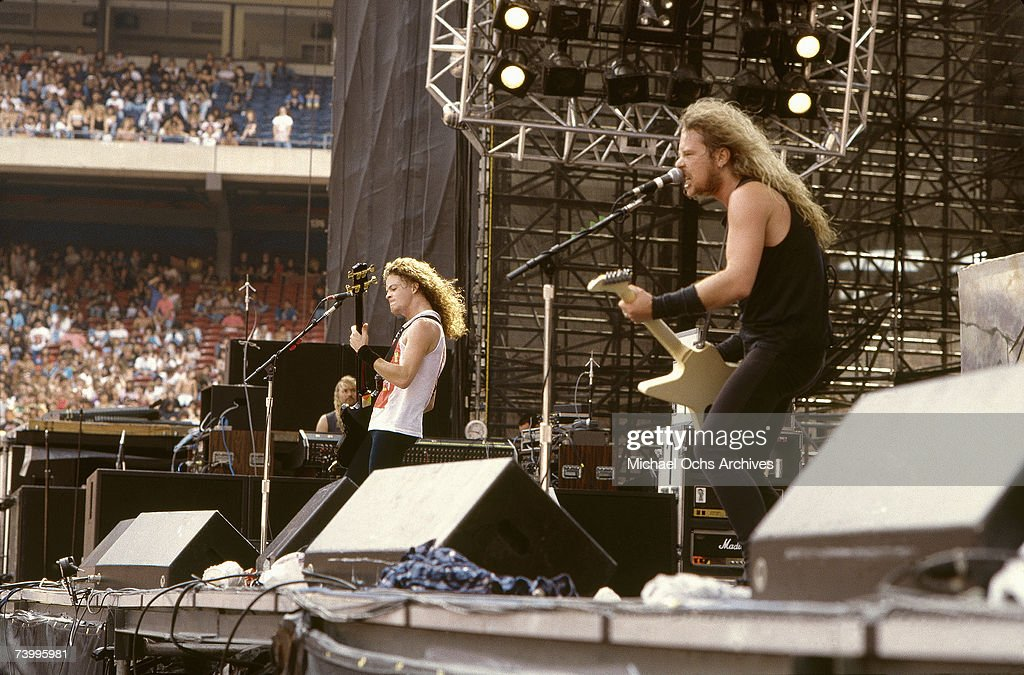Bassist Jason Newsted and Singer and guitarist James Hetfield of the heavy metal quartet 'Metallica' perform onstage at the 'Monsters of Rock' festival at Rice Stadium on July 2, 1988 in Houston, Texas.