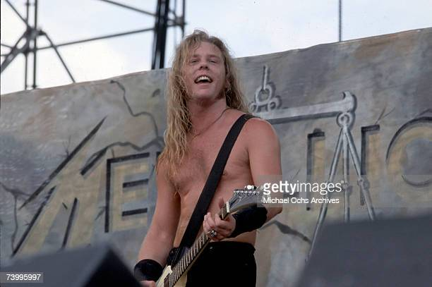 Bassist Jason Newsted of the heavy metal quartet 'Metallica' performs onstage at the 'Monsters of Rock' festival in 1988