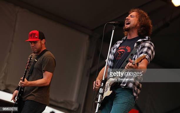 Bassist Jeff Ament and singer Eddie Vedder of Pearl Jam perform during Day 6 of the 41st annual New Orleans Jazz & Heritage Festival at the Fair...