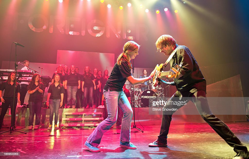 Bassist Jeff Pilson (R) Of The Rock Band Foreigner Interacts With A La Cueva