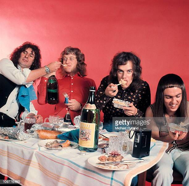 Bassist Jim Lea singer Noddy Holder drummer Don Powell and guitarist Dave Hill of British glam rock band Slade posed in 1974