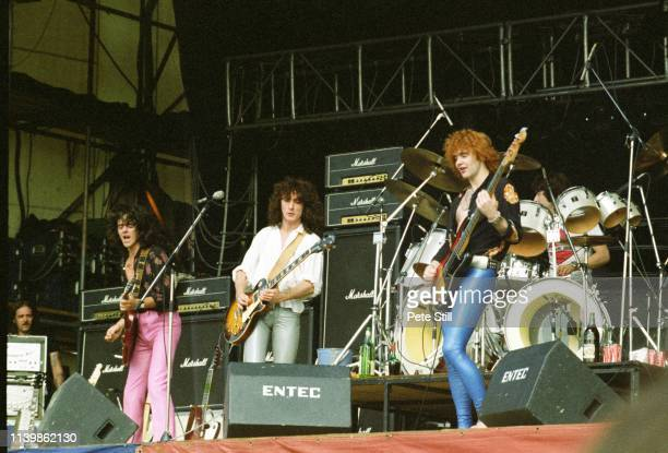 Bassist Jimmy Bain, guitarist Neil Carter and former Thin Lizzy guitarist Brian Robertson of British band Wild Horses perform on stage at The Reading...