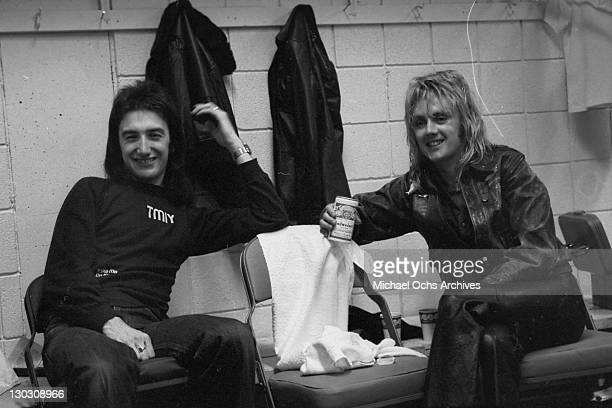 Bassist John Deacon and drummer Roger Taylor of British rock band Queen backstage at the Montreal Forum, 26th January 1977.