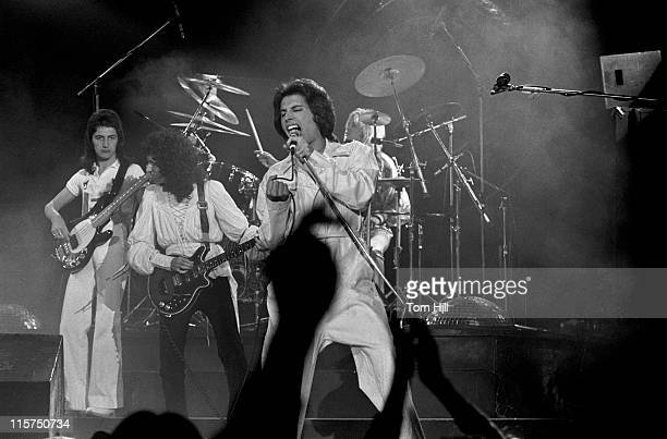 John Deacon Brian May and Freddie Mercury of Queen performing at the Omni