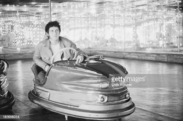 Bassist John Entwistle of English rock group The Who in a dodgem car at a funfair in Felixstowe Suffolk before a concert 9th September 1966