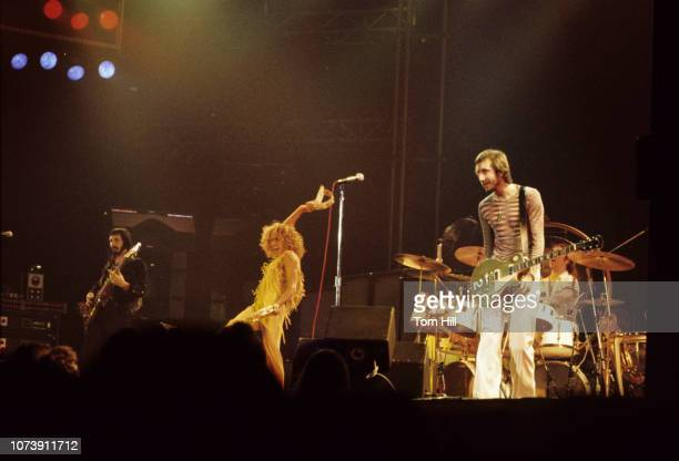 Bassist John Entwistle singerfrontman Roger Daltrey guitarist Pete Townshend and drummer Keith Moon of The Who perform at Murphy Athletic Center of...