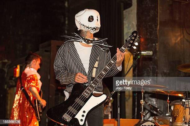 Bassist John Holgado of Attack Attack performs onstage in a Halloween costume in concert at The Emerson Theater on October 26 2012 in Indianapolis...