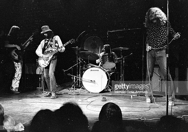 Bassist John Paul Jones guitarist Jimmy Page drummer John Bonham and singer Robert Plant of the rock band 'Led Zeppelin' perform onstage at the Forum...