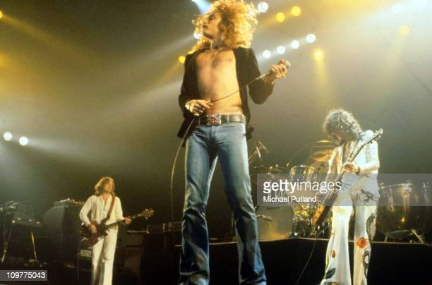 Bassist John Paul Jones, singer Robert Plant and guitarist Jimmy Page of British rock band Led Zeppelin performing on stage at Madison Square Garden...