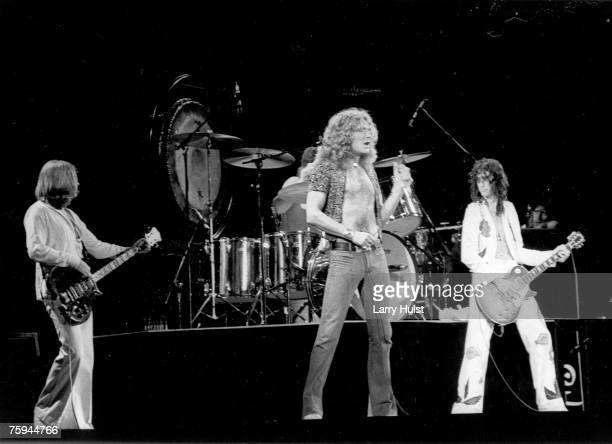 Bassist John Paul Jones singer Robert Plant and guitarist Jimmy Page of the rock band 'Led Zeppelin' perform onstage at the Forum on June 23 1977 in...
