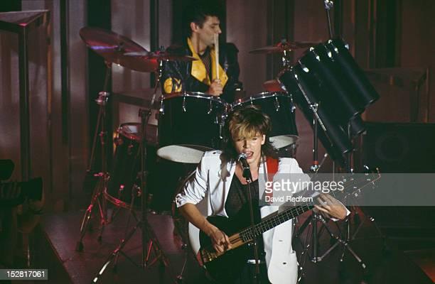 Bassist John Taylor and drummer Roger Taylor performing with English pop group Duran Duran circa 1985