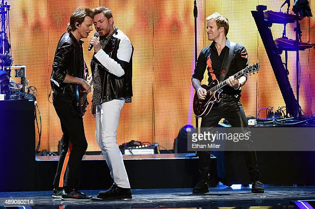 Bassist John Taylor singer Simon Le Bon and touring guitarist Dom Brown of Duran Duran perform onstage at the 2015 iHeartRadio Music Festival at MGM...