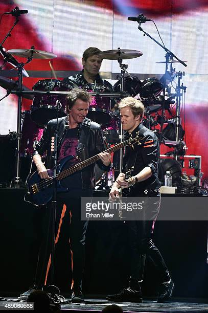 Bassist John Taylor touring guitarist Dom Brown and drummer Roger Taylor of Duran Duran perform onstage at the 2015 iHeartRadio Music Festival at MGM...