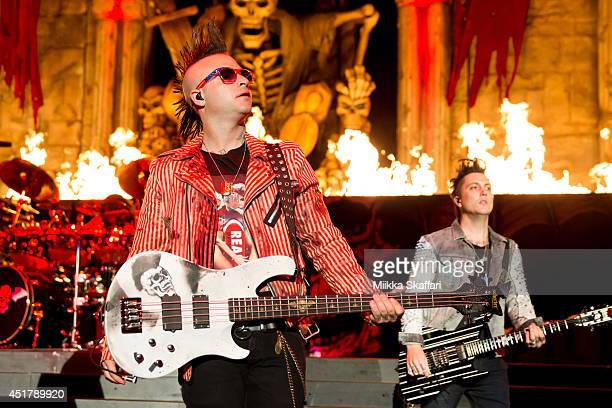 Bassist Johnny Christ and Guitarist Synyster Gates of Avenged Sevenfold perform at the main stage of Rockstar Energy Mayhem Festival on July 6 2014...