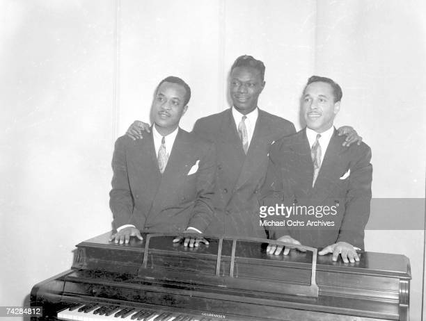 Bassist Johnny Miller pianist Nat 'King' Cole and guitarist Oscar Moore of the Nat 'King' Cole Trio record in Capitol Records studios on December 15...