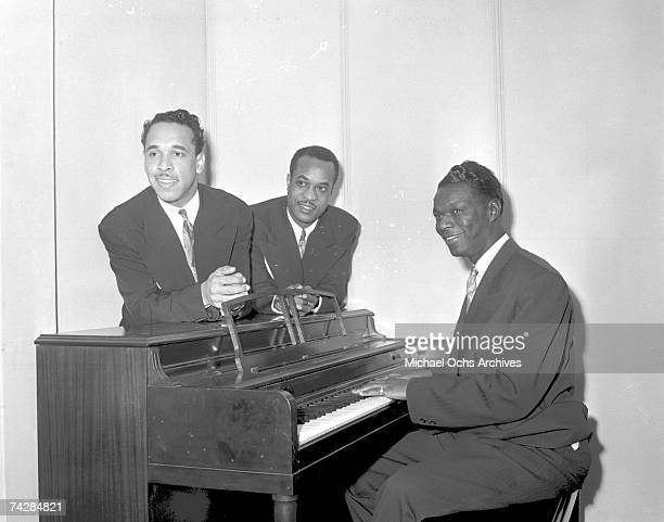 Bassist Johnny Miller pianist Nat 'King' Cole and guitarist Oscar Moore of the 'Nat 'King' Cole Trio' record in Capitol Records studios on December...