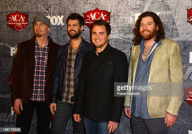 Bassist Jon Jones drummer Chris Thompson frontman Mike Eli and guitarist James Young of the Eli Young Band arrive at the 2012 American Country Awards...