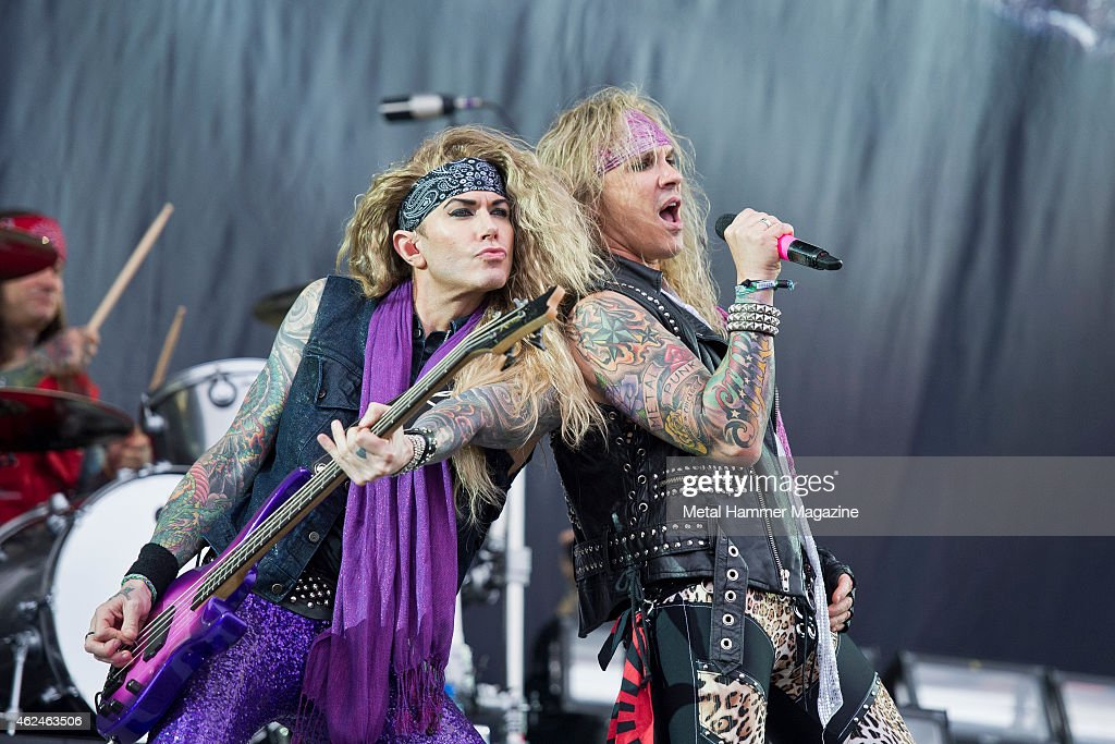 Bassist Lexxi Foxx (L) and vocalist Michael Starr of American glam metal group Steel Panther performing live on the Stephen Sutton Main Stage at Download Festival on June 15, 2014.