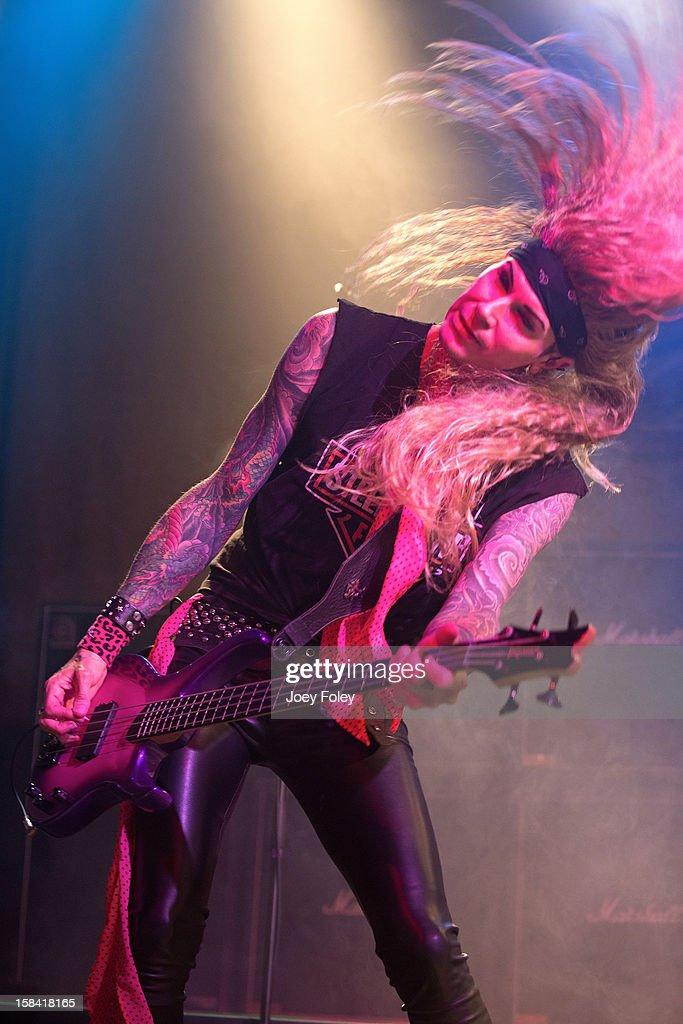 Bassist Lexxi Foxxx aka Travis Haley of Steel Panther performs in concert at Bogart's on December 15, 2012 in Cincinnati, Ohio.