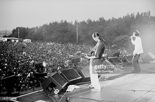 Bassist Mani and singer Ian Brown performing with British rock group The Stone Roses at an outdoor concert at Spike Island Widnes Cheshire 27th May...