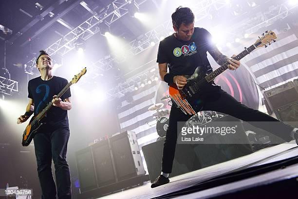 Bassist Mark Hoppus and guitarist Tom DeLonge of Blink 182 perform in concert at Sands Bethlehem Event Center on September 12 2013 in Bethlehem...