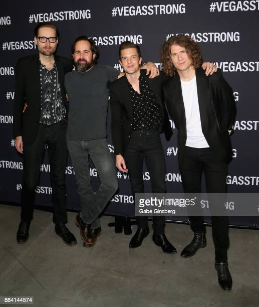 Bassist Mark Stoemer drummer Ronnie Vannucci Jr singer Brandon Flowers and guitarist Dave Keuning of the Killers attend the Vegas Strong Benefit...