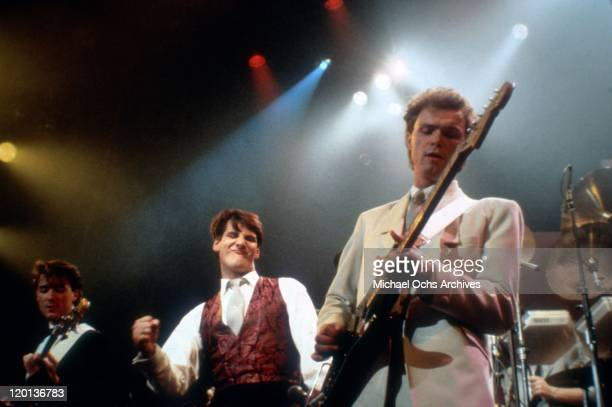 Bassist Martin Kemp singer Tony Hadley and guitarist Gary Kemp of the pop band Spandau Ballet perform onstage in 1983 in Los Angeles California