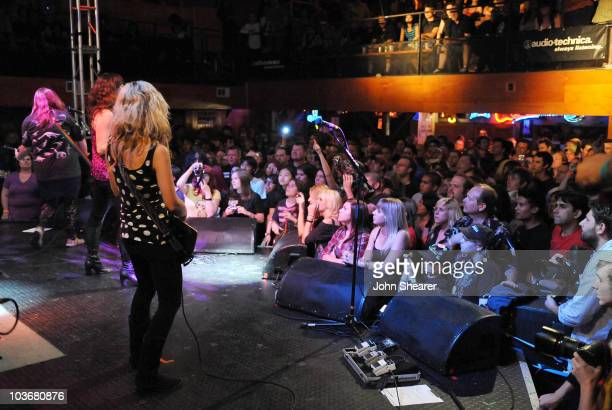 Bassist Maya Ford Singer Brett Anderson and guitarist Allison Robertson of The Donnas perform at the Troubadour on July 17 2009 in West Hollywood...