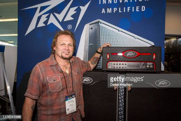 Bassist Michael Anthony poses at the Peavey booth during the 2019 NAMM Show at Anaheim Convention Center on January 26 2019 in Anaheim California