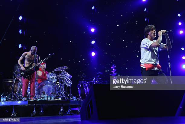 Bassist Michael Flea Balzary drummer Chad Smith and lead singer Anthony Kiedis of Red Hot Chili Peppers perform onstage at WFANs Big Hello To...