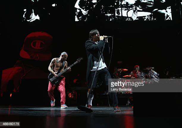 Bassist Michael Flea Balzary lead singer Anthony Kiedis and drummer Chad Smith of Red Hot Chili Peppers perform onstage at WFANs Big Hello To...
