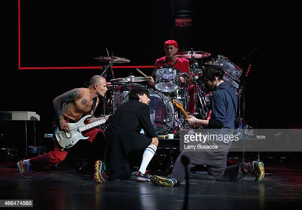 Bassist Michael Flea Balzary lead singer Anthony Kiedis drummer Chad Smith and guitarist Josh Klinghoffer of Red Hot Chili Peppers perform onstage at...