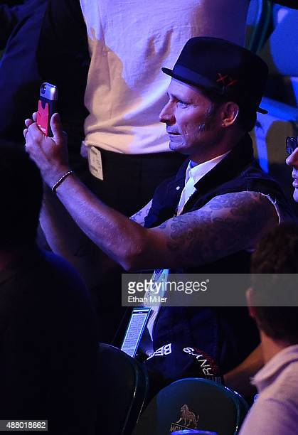 Bassist Mike Dirnt of Green Day watches Roman Martinez and Orlando Salido during their WBO junior lightweight title fight at MGM Grand Garden Arena...